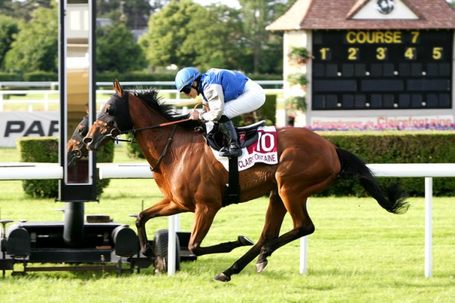 CASQUITO (Delphine Santiago) easing past the winning post to take the Prix Equipement du Cavalier - Hippolia (Prix des Pervenches) (Course 7), June 25, 2015 at Deauville-Clairefontaine. (Photo by Frédéric Vernichon.)